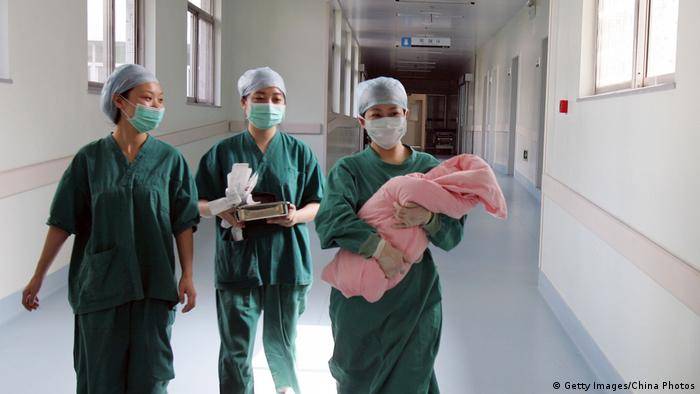 Nurses and baby in China