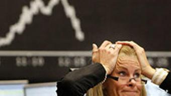 A broker reacts at the stock exchange in Frankfurt, central Germany, on Tuesday Sept. 16, 2008.
