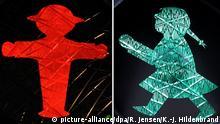 ARCHIV - KOMBO - Die Bildkombo zeigt einen roten Ampelmann, aufgenommen am 09.08.2011 in Berlin und eine grüne Ampelfrau, aufgenommen am 11.03.2013 in Sonthofen (Bayern). Foto: Rainer Jensen/Karl-Josef Hildenbrand/dpa (Zu dpa Union und SPDwollen feste Frauenquote in Aufsichtsräten) +++(c) dpa - Bildfunk+++ | Verwendung weltweit