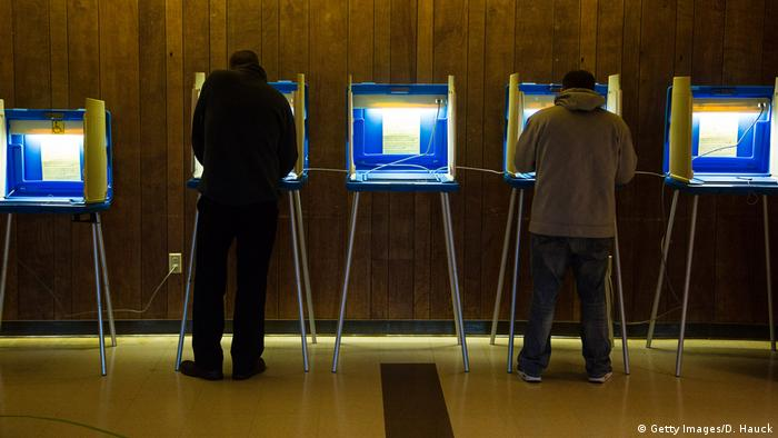Voters cast their ballot in the national election at Cannon Pavilion on November 8, 2016 in Milwaukee, Wisconsin (Getty Images/D. Hauck)