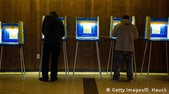 People vote at electric voting machines
