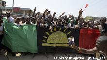 ARCHIV 2015 +++ Pro-Biafra supporters shout slogans in Aba, southeastern Nigeria, during a protest calling for the release of a key activist on November 18, 2015. The protesters support the creation of a breakaway state of Biafra in the southeast and want the release of Nnamdi Kanu, who is believed to be a major sponsor of the Indigenous People of Biafra (IPOB) and director of the pirate radio station Radio Biafra. AFP PHOTO / PIUS UTOMI EKPEI (Photo credit should read PIUS UTOMI EKPEI/AFP/Getty Images)