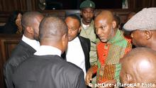 FILE- In this Friday Jan. 29, 2016 file photo, Biafran separatist leader Nnamdi Kanu, center right, speaks to his lawyers at the Federal High court in Abuja, Nigeria. Nigerian separatists have hijacked a merchant ship and threatened to blow it up with its foreign crew if authorities do not release detained leader Nnamdi Kanu agitating for a breakaway state of Biafra, military officers said Tuesday, Feb. 2, 2016.(AP Photo/ File) |