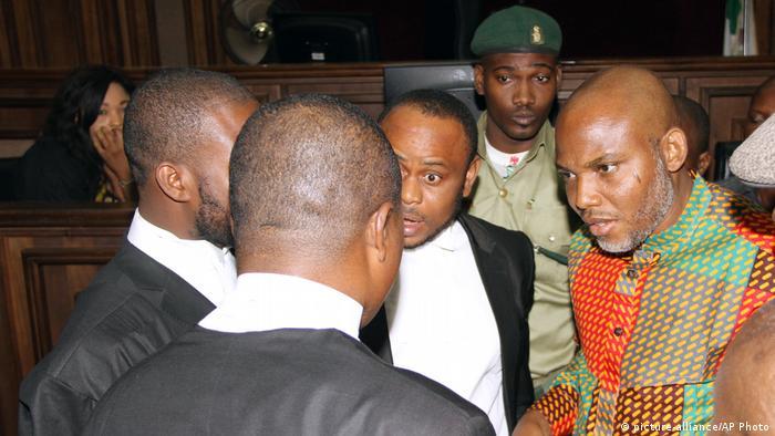 Biafran Separatist Nnamdi Kanu speaks to lawyers during a 2016 trial