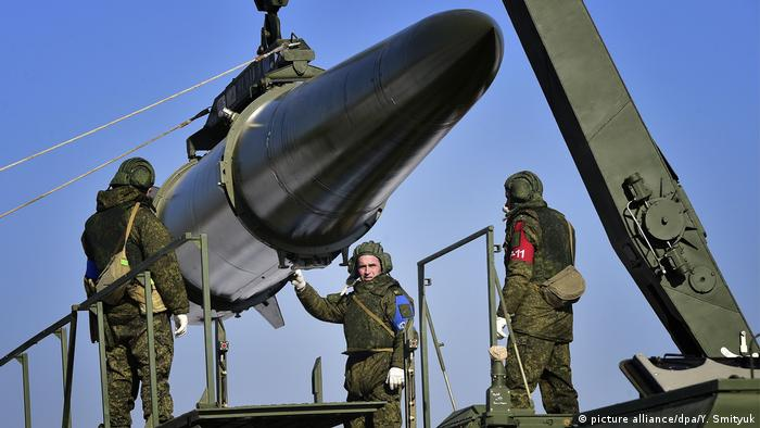 Loading a quasi ballistic missile into an Iskander-M missile launcher during a military exercise held by missile and artillery units of the Russian Eastern Military District's 5th army at a firing range in Ussuriysk.