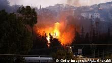 A picture taken on November 24, 2016 shows a fire raging in the northern Israeli port city of Haifa. Hundreds of Israelis fled their homes on the outskirts of the country's third city Haifa with others trapped inside as firefighters struggled to control raging bushfires, officials said. / AFP / AHMAD GHARABLI (Photo credit should read AHMAD GHARABLI/AFP/Getty Images)