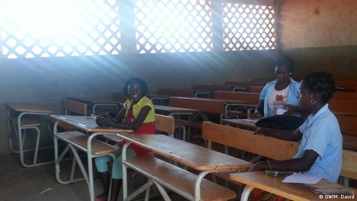 classroom in Mozambique, desks and a few students
