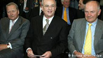 Porsche chairman Wolfgang Porsche (left), Volkswagen CEO Martin Winterkorn (middle) and Volkswagen chairman and Porsche heir Ferdinand Piech (right)