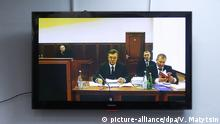 25.11.2016 ROSTOV-ON-DON, RUSSIA - NOVEMBER 25, 2016: The screen shows Ukraine's former president Viktor Yanukovych (C) and his lawyer Vitaly Serdyuk (R front) at the Rostov-on-Don Region Court, testifying in the February 2014 Kiev mass protest case via video link with Kiev's Svyatoshin District Court. The case was initiated against members of Ukraine's former Berkut riot police unit, accused of shooting the protesters. Valery Matytsin/TASS |