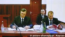 25.11.2016 ROSTOV-ON-DON, RUSSIA - NOVEMBER 25, 2016: The screen shows Ukraine's former president Viktor Yanukovych and his lawyer Vitaly Serdyuk (L-R front) at the Rostov-on-Don Region Court, testifying in the February 2014 Kiev mass protest case via video link with Kiev's Svyatoshin District Court. The case was initiated against members of Ukraine's former Berkut riot police unit, accused of shooting the protesters. Valery Matytsin/TASS  