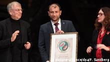 epa05647554 Raed al-Saleh (C) head of the Syria Civil Defence, also known as the White Helmets, receives the Right Livelihood Award from Jakob von Uexkull, (L), the founder of the award, during a ceremony at the Vasa Museum in Stockholm, Sweden, 25 November 2016. The Right Livelihood Award is an international award to recognise those who develop solutions for today's pressing concerns. EPA/FREDERIK SANDBERG SWEDEN OUT +++(c) dpa - Bildfunk+++  