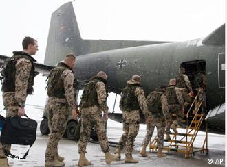 German soldiers entering a Transall C-160 cargo plane at the military airbase Penzing, 50 kilometers (28 miles) west of Munich