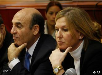 **FILE** In this Sunday, Sept. 14, 2008 file photo, Kadima party leadership candidates, Israeli Transportation Minister Shaul Mofaz, left, and Israeli Foreign Minister Tzipi Livni, attend the weekly cabinet meeting in Jerusalem. Israel's popular foreign minister Tzipi Livni squares off against a tough-talking military man Shaul Mofaz on Wednesday when the ruling Kadima Party chooses a new leader to replace Prime Minister Ehud Olmert, who is being forced from office by a corruption scandal. (AP Photo/Dan Balilty, Pool, File)