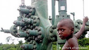 A Nigerian boy plays close to an oil well in Olomoro village in Isokoarea of the delta region.
