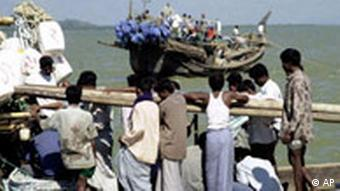 A group of fishermen get ready to launch their boats in the sea at Cox's Bazar sea shore, 295 kilometers (185 miles) southeast of Dhaka, Bangladesh, Friday, Nov.15, 2002. At least 150 fishermen were missing after 19 boats sank in a fierce tropical strom off Bangladesh's coast Wednesday. (AP Photo/Pavel Rahman)