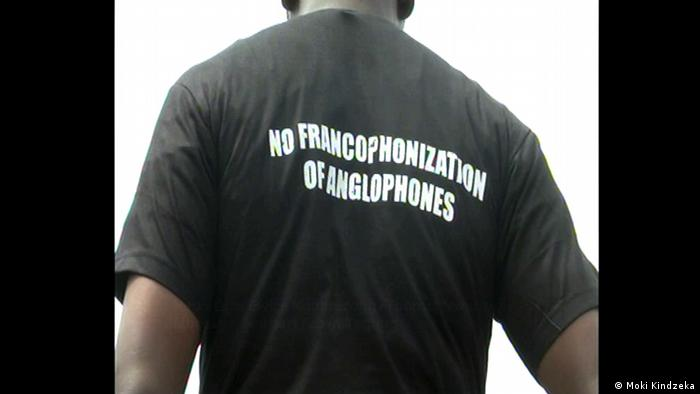 A man wearing a Tshirt saying no Francophonization of Anglophones