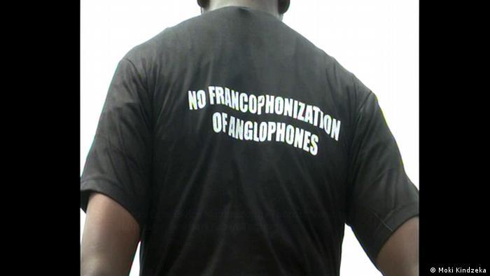 A man wearing a Tshirt saying no Francophonization of Anglophones (Moki Kindzeka)