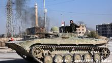 28.11.2016+++A member of Syrian pro-government forces drives a tank in the Haydariya northeastern neighbourhood in Aleppo on November 28, 2016, after they took control of the area from rebel fighters as part of their assault to retake the entire northern city. In a major breakthrough in the push to retake the whole city, regime forces captured six rebel-held districts of eastern Aleppo over the weekend, including Masaken Hanano, the biggest of those in eastern Aleppo. The army captured the Sakhur, Haydariya and Sheikh Khodr neighbourhoods on November 28, 2016 while Kurdish forces took the Sheikh Fares district from rebels, the Syrian Observatory for Human Rights said. / AFP / GEORGE OURFALIAN (Photo credit should read GEORGE OURFALIAN/AFP/Getty Images)