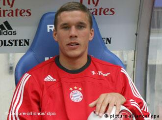 Bayern Munich striker Lukas Podolski sits on the bench