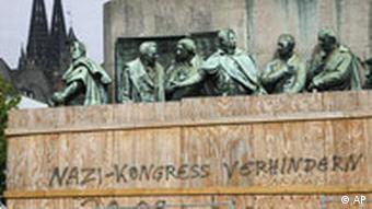 Prevent Nazi Congress is written on a monument in Cologne