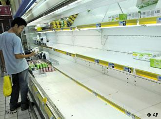 Shelves have been emptied from tainted milk products at this supermarket in Shanghai