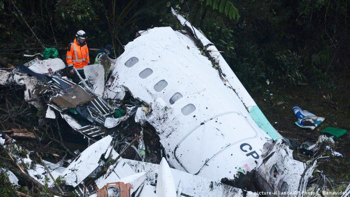 Rescue workers search at the wreckage site of a chartered airplane that crashed outside Medellin, Colombia