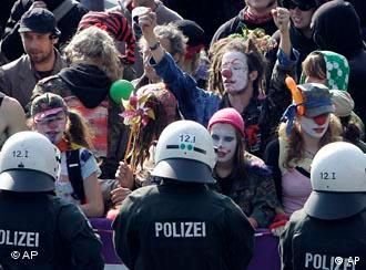 Demonstrators dressed as clowns protest against the 'anti-Islamification' conference in Cologne, Germany on Sept. 20, 2008