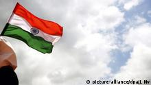 epa05479590 An Indian child holds the Indian national flag during rehearsal for India's Independence Day parade and celebrations in Bangalore, India, 13 August 2016. India's 70th Independence Day will be celebrated on 15 August, to commemorate its independence from British rule and its birth as a sovereign nation on that day in 1947. EPA/JAGADEESH NV |