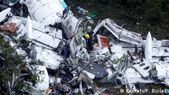 Rescue crew work at the wreckage from a plane that crashed into Colombian jungle