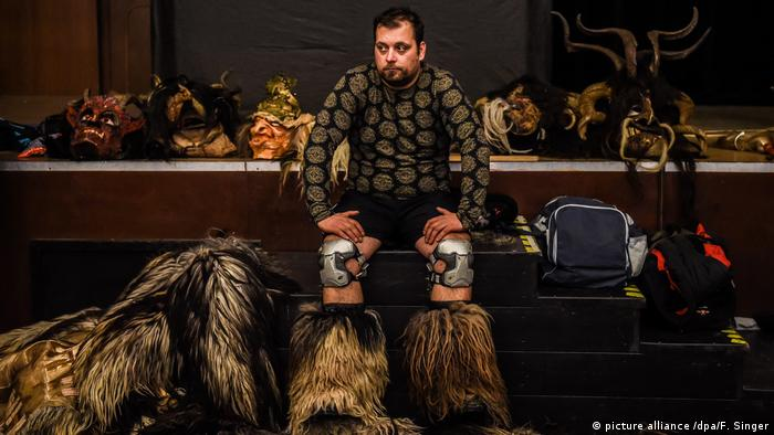 Krampus (picture alliance /dpa/F. Singer)Parts of the Czech Republic also keep up with the folklore. In South Bohemia, a Krampus participant gets some rest after a parade. The knee protectors are signs for the undoubtedly boisterous run.