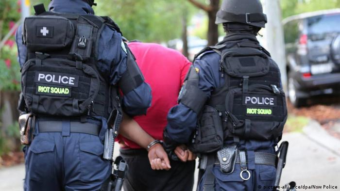Police arrest a suspected terrorist during a counter-terrorism operation
