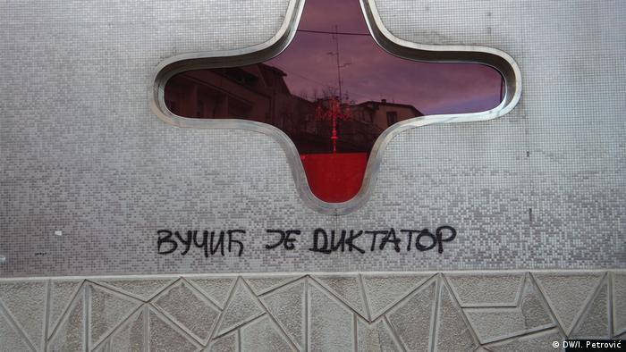 'Vucic is a dictator' reads the graffiti in Belgrade