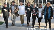12.09.2016 (L to R) Bai Shuanfu, a relative of one of the victims from Malaysia Airlines flight MH370 which disappeared in 2014, US amateur investigator Blaine Gibson, and relatives and support group members Jiang Hui, Jennifer Chong, Sheryl Keen, Grace Nathan and Kaye Russell, pose together after a meeting with the Australian Transport and Safety Bureau and the Joint Agency Coordination Centre in Canberra on September 12, 2016. A US amateur investigator handed possible debris from missing flight MH370 to Australian officials on September 12, saying several pieces had been blackened by flames, raising the idea of a flash fire onboard. / AFP / MARK GRAHAM (Photo credit should read MARK GRAHAM/AFP/Getty Images)