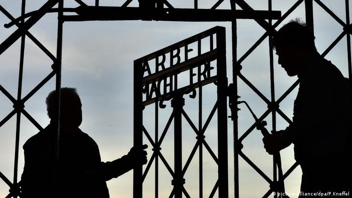 The main gate of the former concentration camp, with the infamous Nazi slogan 'Arbeit macht frei' (Work sets you free)