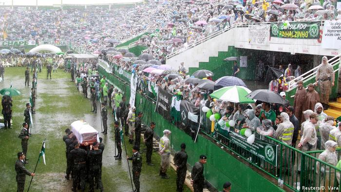 The coffin of one of the victims of the plane crash in Colombia arrives at the Arena Conda stadium in Chapeco Chapecoense