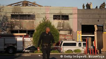Firefighters and police at the scene of a overnight fire that claimed the lives of at least nine people at a warehouse in the Fruitvale neighborhood (Getty Images/E. Nouvelage)