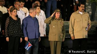 Raul Castro (saluting), surrounded by other foreign leaders, paid tribute to his late brother (Reuters/C. Barria)