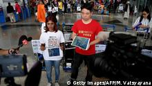 Malaysia Airlines MH370 Demonstration Kuala Lumpur Flughafen (Getty Images/AFP/M. Vatsyayana)