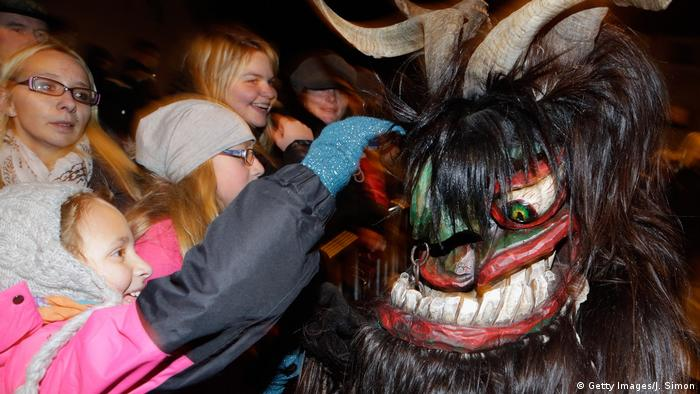 Not all Krampuses are scary though and these brave children in Salzburg, Austria, don't seem to be too intimidated by this monster.