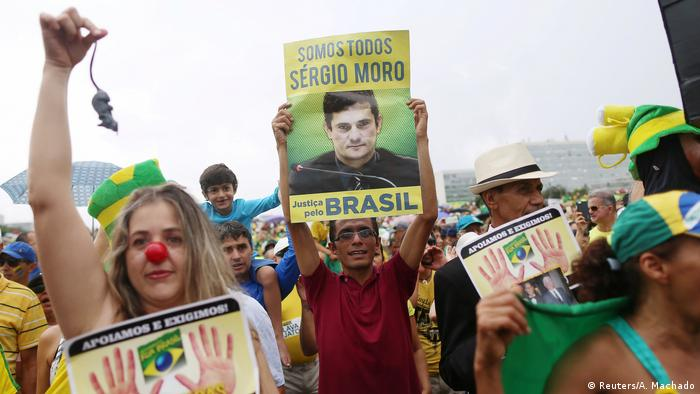 Picture of Sergio Moro on a poster at a protest