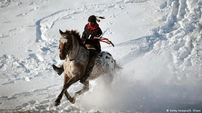 A Native American activist rides down from a ridge the edge of the Standing Rock Sioux Reservation