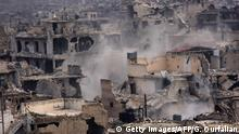05.12.2016 CORRECTION - A picture taken on December 5, 2016 shows destroyed buildings in Aleppo's eastern al-Shaar neighbourhood as Syrian pro-government troops advance towards the area through Karm al-Jabal district during their offensive to retake Syria's second city. The Syrian Observatory for Human Rights said the advances of the Syrian and allied forces left the large Shaar neighbourhood encircled by government forces and in danger of falling from rebel control. With the capture of Shaar, the army would hold 70 percent of east Aleppo, four years after rebels first seized it. / AFP / GEORGE OURFALIAN / The erroneous mention[s] appearing in the metadata of this photo by GEORGE OURFALIAN has been modified in AFP systems in the following manner: [al-Shaar] instead of [Karm al-Jabal]. Please immediately remove the erroneous mention[s] from all your online services and delete it (them) from your servers. If you have been authorized by AFP to distribute it (them) to third parties, please ensure that the same actions are carried out by them. Failure to promptly comply with these instructions will entail liability on your part for any continued or post notification usage. Therefore we thank you very much for all your attention and prompt action. We are sorry for the inconvenience this notification may cause and remain at your disposal for any further information you may require. (Photo credit should read GEORGE OURFALIAN/AFP/Getty Images)