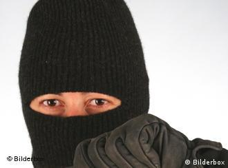 The ski mask certainly wasn't what gave the thief away