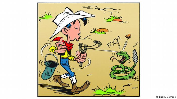 Lucky Luke shoots slingshot at snake (Lucky Comics)