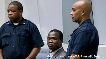 Dominic Ongwen sits in the court room of the International Criminal Court in The Hague, Netherlands,