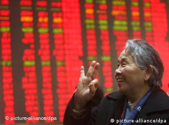 Chinese shareholders watch the price of stocks go up