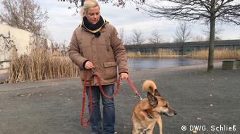 Woman and dog on leash
