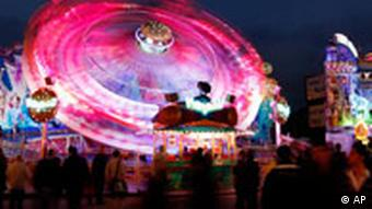 In this evening snapshot, the colors from the rides at Oktoberfest swirl together