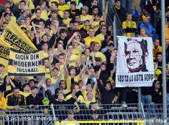 Borussia Dortmund fans display their offensive banners