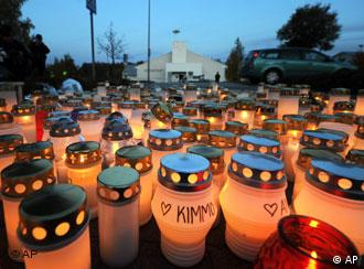 Candles are seen lit near the Kauhajoki vocational high school in Kauhajoki, western Finland